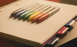 Colored markers on a notebook.Back to school supplies royalty free stock photography