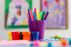 Colored markers and paint Royalty Free Stock Image