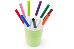 Colored markers are in a plastic cup Royalty Free Stock Photos