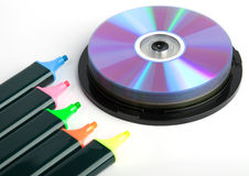 Colored markers and spindel of compact disks Stock Images