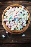 Colored marshmallow on the wooden table Royalty Free Stock Photos