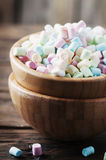 Colored marshmallow on the wooden table Stock Image