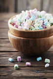 Colored marshmallow on the wooden table Stock Images