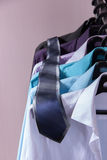 Colored men's shirts that hang on hangers. Colored men's shirts that hang on black hangers Stock Photography