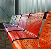 Colored metal bench at a tram bus train stop Royalty Free Stock Image