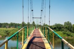 Rustic metal footbridge at summer time Royalty Free Stock Photography