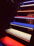 Colored metal stairs on a night club royalty free stock photos