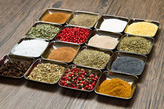 Colored and mixed spice in box on wood background Stock Photography
