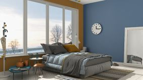 Colored modern blue and yellow bedroom with big panoramic window Stock Photo