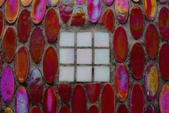 Colored mosaic on a concrete wall Stock Image