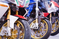 Colored motorbikes Stock Photos