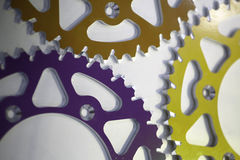 Colored motorcycle sprockets Royalty Free Stock Photos