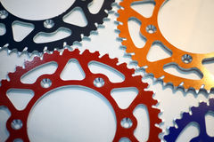 Colored motorcycle sprockets Stock Photos