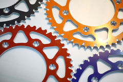 Colored motorcycle sprockets Royalty Free Stock Photography