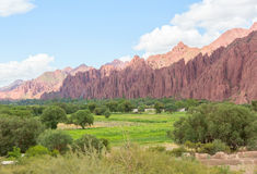 Colored mountains and green valley Royalty Free Stock Photos