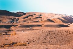 Colored mountains under the blue sky. Red hills of Kyzyl-Chin, Altai. Martian landscape. Red canyon Stock Image
