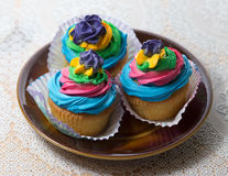 Colored muffin cakes. Royalty Free Stock Images
