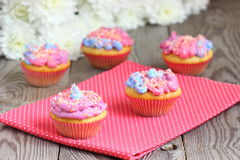 Colored muffins. Bright colored muffins with flowers. Shallow DOF stock photos