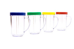 Colored mugs. Isolated on white background royalty free stock photos