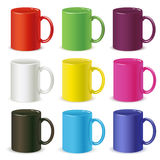 Colored mugs Stock Images