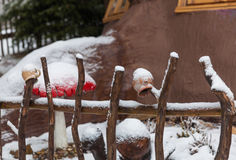 Colored mugs on a wooden fence in a winter village Royalty Free Stock Photo
