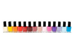 Colored Nail Polish In A Row Royalty Free Stock Photography