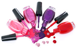 Colored nail polish  spilling from bottles Royalty Free Stock Photography