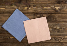 Colored napkin on a wooden table. Royalty Free Stock Photography
