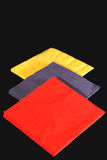 Colored Napkins On Black Royalty Free Stock Photos