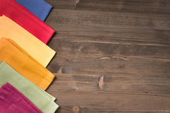 Colored napkins from  left side table wooden Royalty Free Stock Image