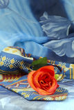 Colored necktie with red roses on a blue background Stock Image