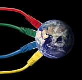 Colored Network Cables wired to the Earth Globe Stock Photo