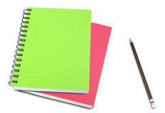 Colored notebook and pencils isolated on white Stock Photo