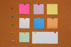 Colored notes on cork board  Stock Images