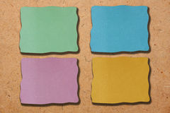 Colored notes paper. Ob plywood Royalty Free Stock Images