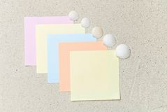 Colored notes with seashells on sand Royalty Free Stock Photo