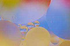Colored oil droplets on the water surface Royalty Free Stock Photo