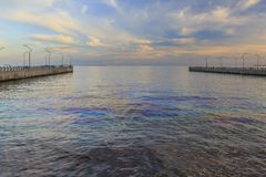 Colored oil spills in the Caspian Sea. Nature royalty free stock photo