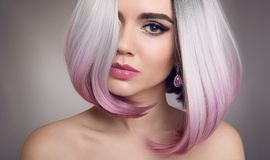 Colored Ombre bob hair extensions. Beauty Blonde Model Girl with. Short pink hairstyle on gray background. Closeup woman portrait stock images