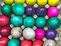 Colored onyx easter eggs. Colored onyx easter decoration eggs background Royalty Free Stock Image