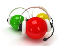 Colored orbs with headset  over white Stock Images