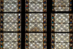 Colored ornamental glass of window of the church Stock Photos