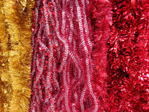 Colored ornamental tinsel Stock Photos