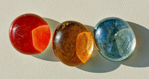 Colored oval cabochons for crafts. Stock Photos