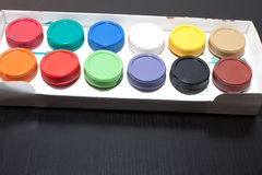 Colored paint artist on gray background Royalty Free Stock Photography