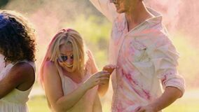 Colored paint battle at Holi festival, friendly atmosphere, super-slow motion. Stock footage stock video