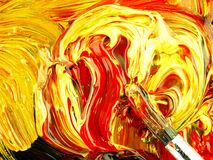Colored paint mixed on palette. Dirty brush in the foreground. royalty free stock images