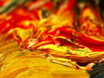 Colored paint mixed on palette. Stock Images