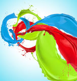 Colored paint splashes. On light blue background Royalty Free Stock Photos