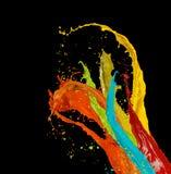 Colored paint splashes on black background. Colored paint splashes isolated on black background Stock Photo